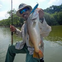 Fadzly posing with the king of estuary, The Barramundi